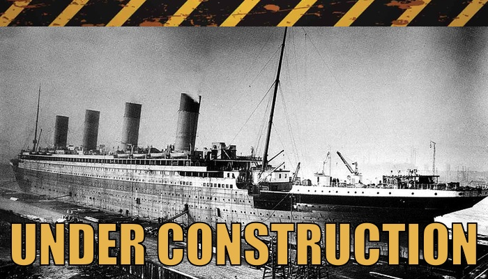 """Under Construction"" warning stripes with a photo of RMS Titanic under construction"